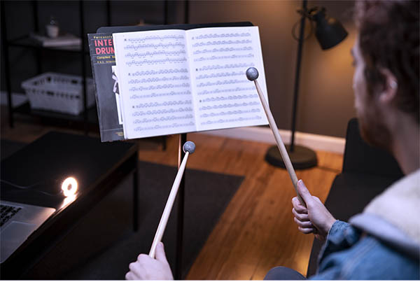Triple-image of drummers practicing, performing, and recording with Aerodrums