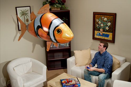 Air Swimmer Clownfish flying in a living room.