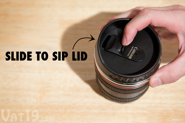 Thumb slider sip cover on the Camera Lens Mug.