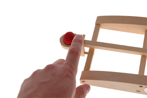 Pull back the ping pong launcher on your catapult and release to fire