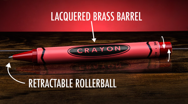 Crayon pen has a lacquered brass barrel on the outside and a retractable rollerball on the inside.