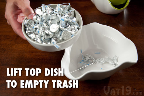 Simply lift the top dish to empty the trash of the Double Dish Snack Bowl.