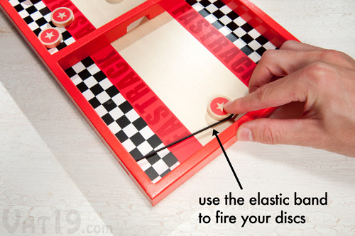 Use the elastic cord to send your wooden discs zooming to the other side.