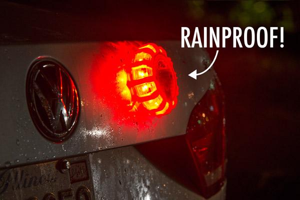 Rain repelling off of roadside light