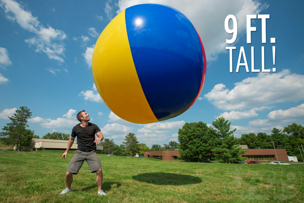 Man about to be flattened by a 9-foot-tall beach ball.