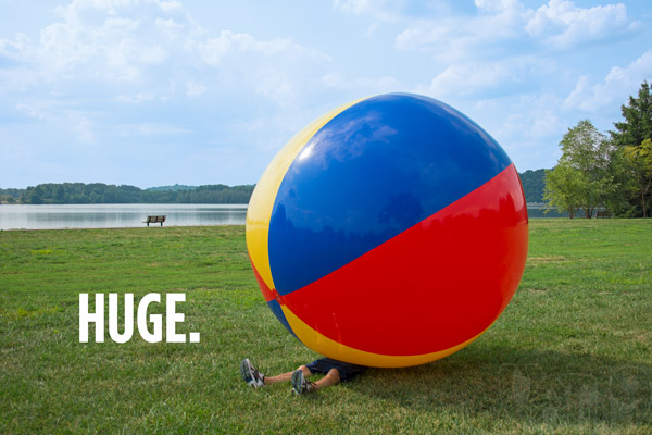https://images.vat19.com/giant-beach-ball/massive-beach-ball-man.jpg