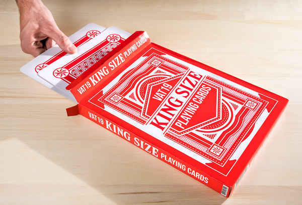 Hands pulling King Size Playing Cards from its cool box.