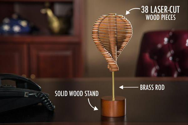 Helicone is made from 38 laser-cut wood pieces on a brass rod and fits in a solid wood stand.