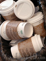 A pile of paper cups in the garbage