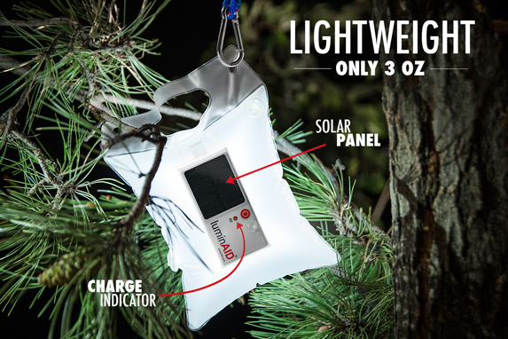 LuminAID Solar-Powered Lantern hanging from a tree.