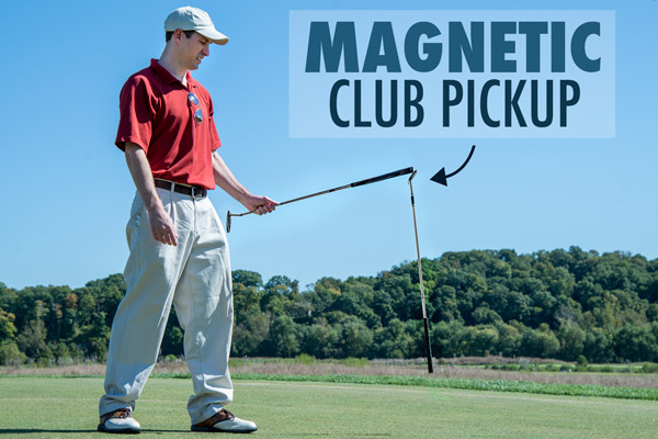 Man on a putting green using the Magnecaddy Club Retrieval System.