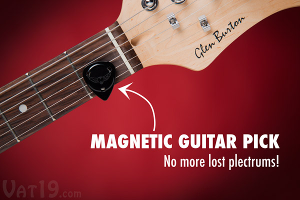 Magnetic Guitar Pick adhered to strings of electric guitar.