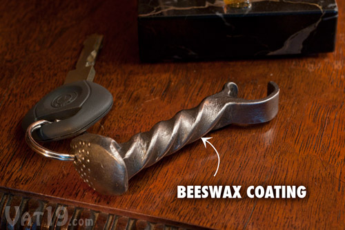 The Mine Train Spike Bottle Opener features a protective beeswax coating.