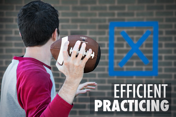 Man is aiming Passback Training Football at a small bullseye on a wall.