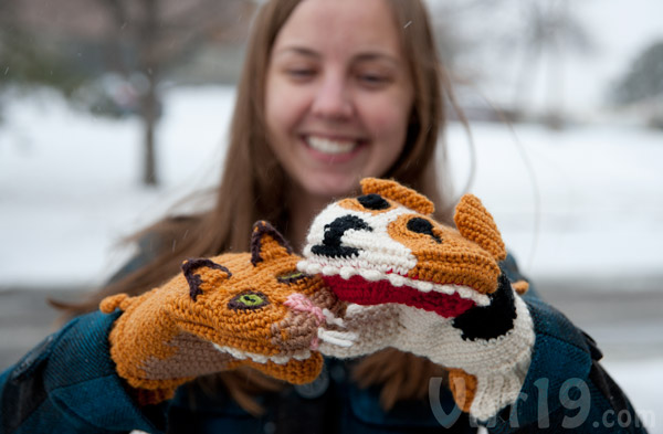 Adults will love these spirited versus mittens.
