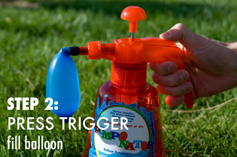 Step 2: Press the trigger to fill the balloon with water or air.