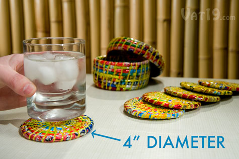 Set of six recycled plastic coasters with storage box.