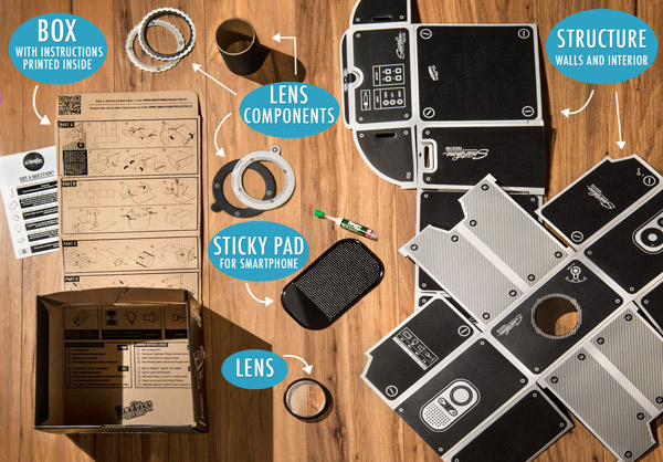 DIY Smartphone Projector components on a table.