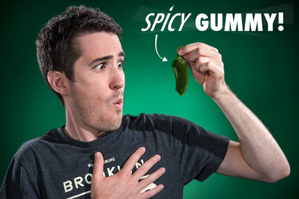 Man reacting to the surprising, yet delicious heat of the Spicy Gummy Pepper.