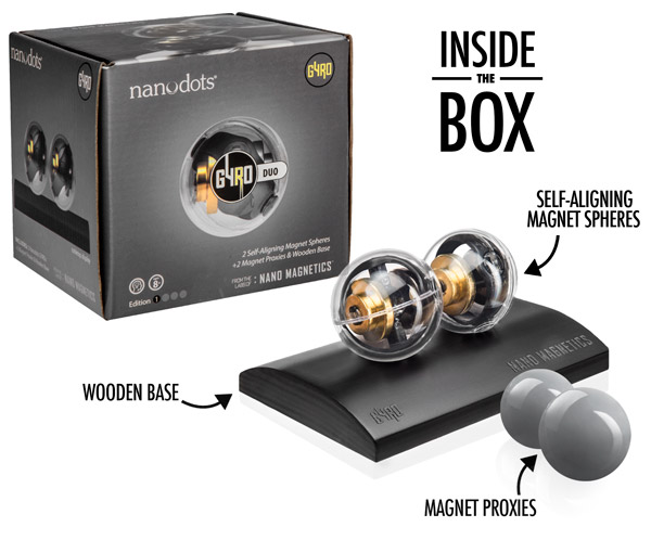 The set includes two self-aligning magnet spheres, two magnetic proxies, and a wooden base.