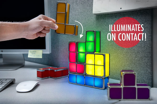 Man adding a tetrimino to his Tetris Lamp in an office.