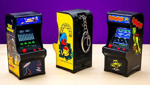 The mini arcade cabinets side-by-side