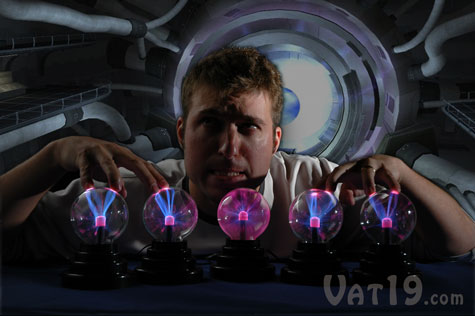 A man plays with five Plasma Balls