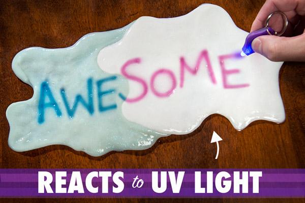 Man writing on Phantom Putty with the UV Keychain Light. Phantom UV Thinking Putty  Changes color under ultraviolet light
