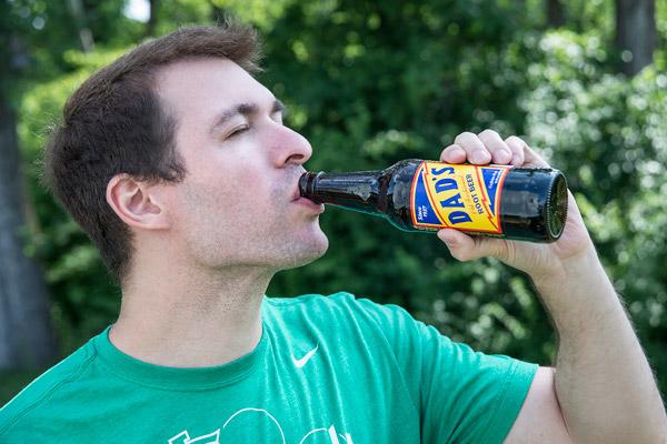 Man drinking a Dad's Root Beer.