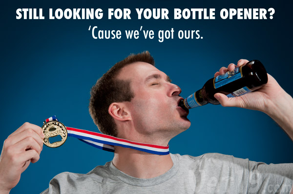 Man showing off his awesome beer bottle medal while downing a beer.