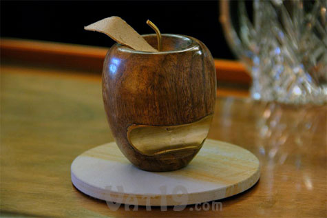 Instead of a hidden in a drawer, display this Wooden Apple Bottle Opener with pride